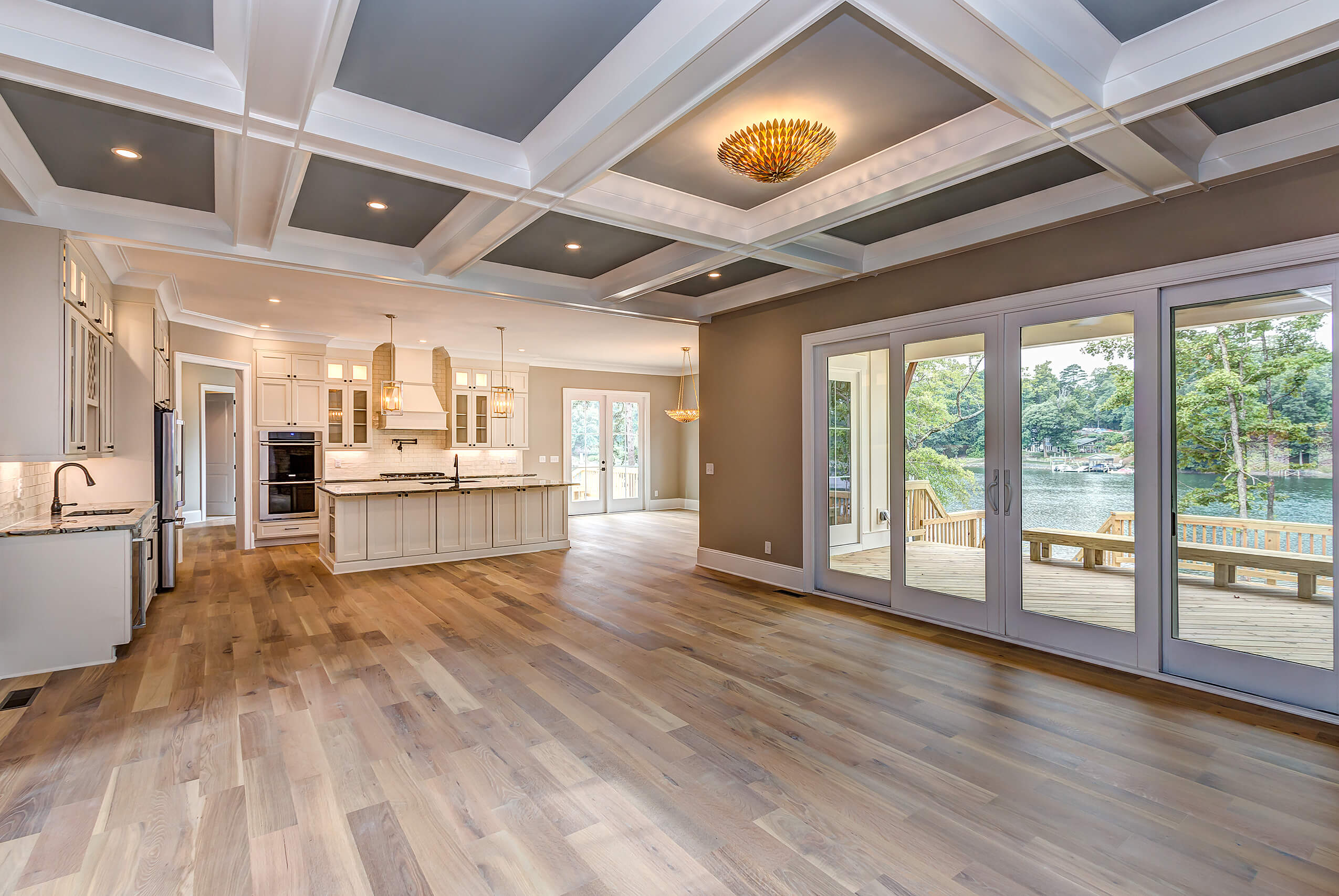 Kitchen and living room with engineered white oak floors finished with Rubio Monocoat products.