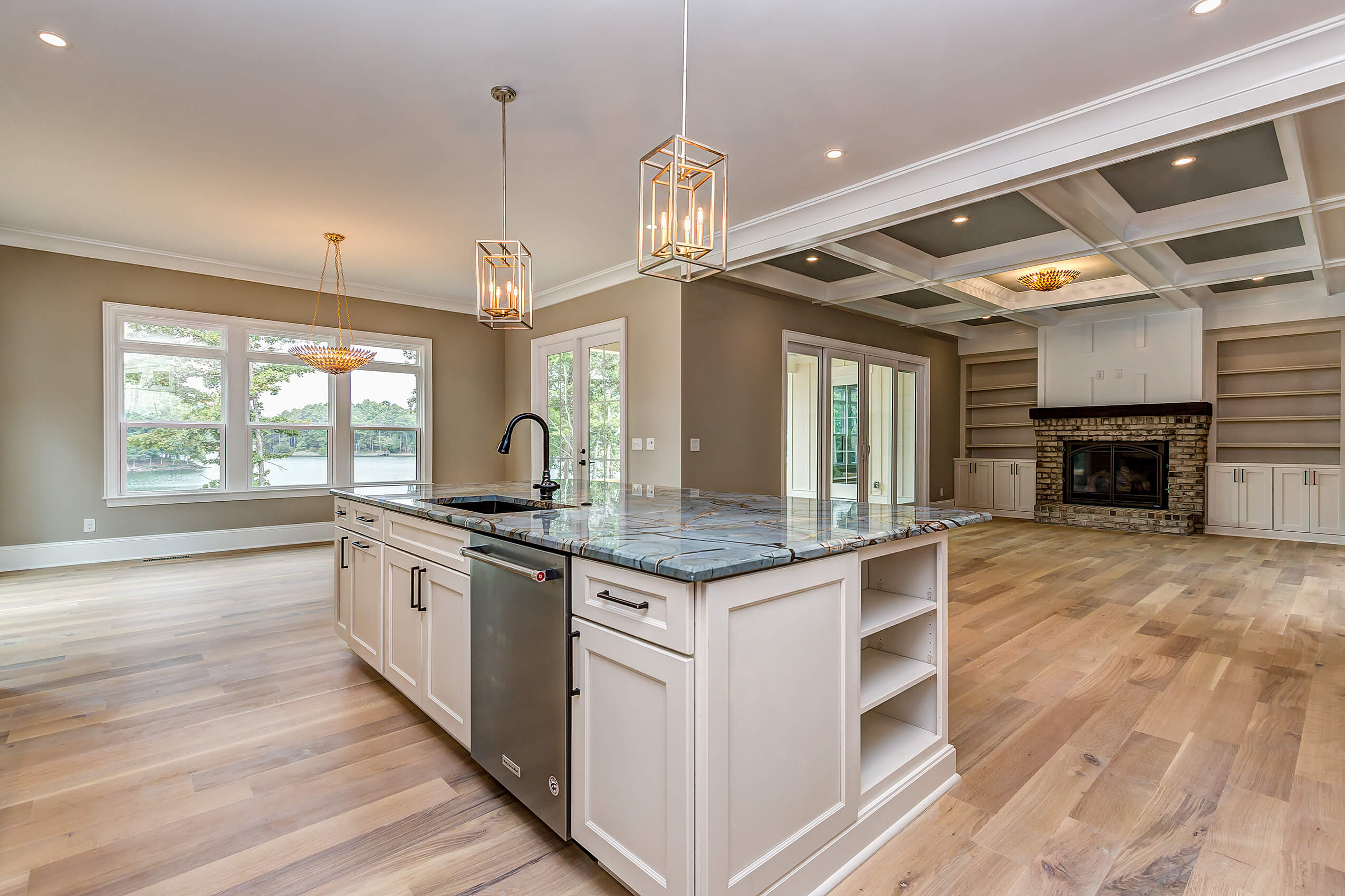 Kitchen island contrasts with beautiful white oak flooring.