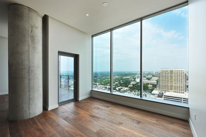 Hotel rooms with beautiful views of Austin, TX feature wood floors finished with Rubio Monocoat.