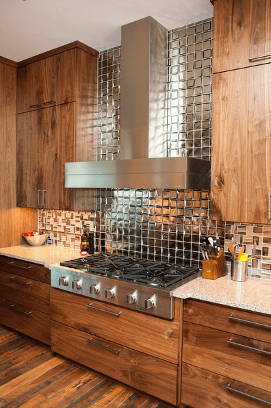 Rustic wood drawer fronts and cabinetry in a kitchen.