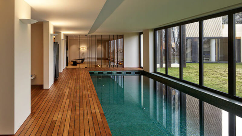 Indoor pool with teak wood deck finished with natural hardwax oil wood finish.