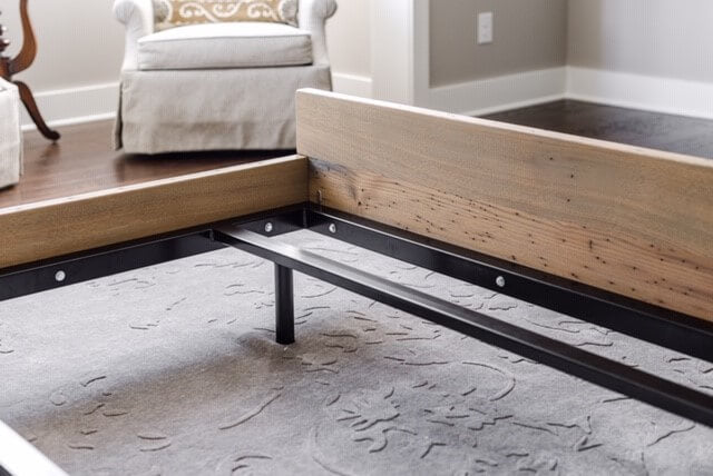 Natural wood bed-frame
