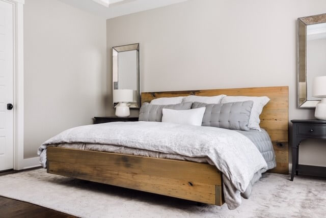 American Wormy Chestnut bed-frame in a master bedroom.