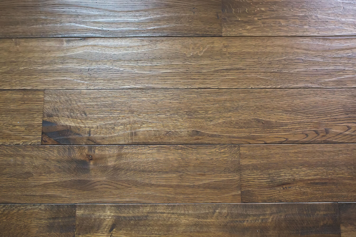 Unique texture created by hand scraping white oak floors and then finishing them with Rubio Monocoat.