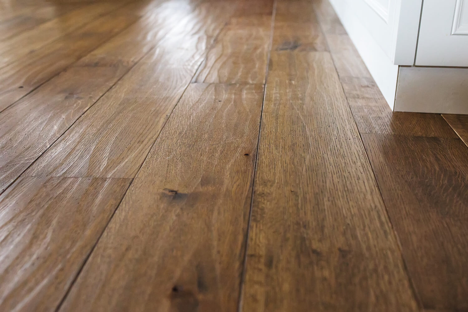 Detail shot of hand scraped white oak floor finished with hardwax oil.
