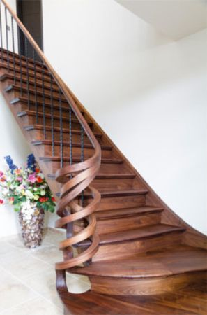 Walnut staircase hand rails finished with Rubio Monocoat's hardwax oil wood finish.