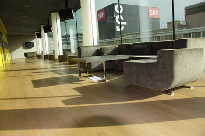 Hardwood flooring in a commercial lounge.