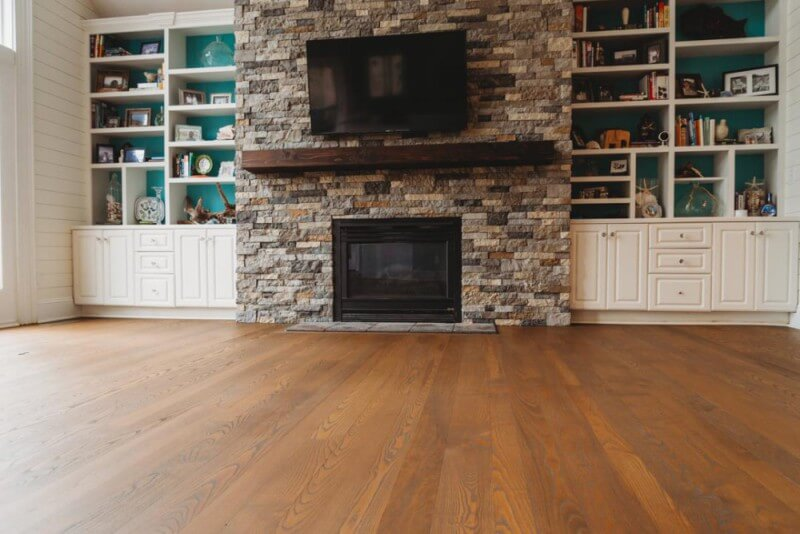 Fireplace in living room with hardwood floors finished with Rubio Monocoat.