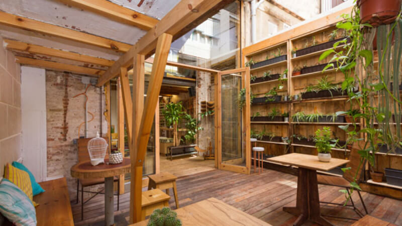 Garden room in restaurant filled with wood finished with Rubio Moncoat.