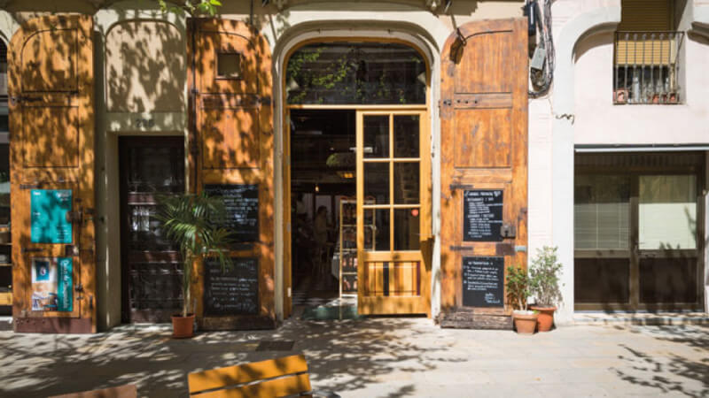 Front door of beautiful restaurant in Barcelona that features wood finished with Rubio Monocoat.