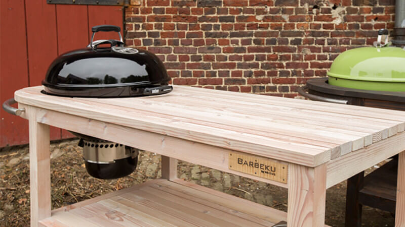 Wooden BBQ carts that hold your charcoal barbeque.