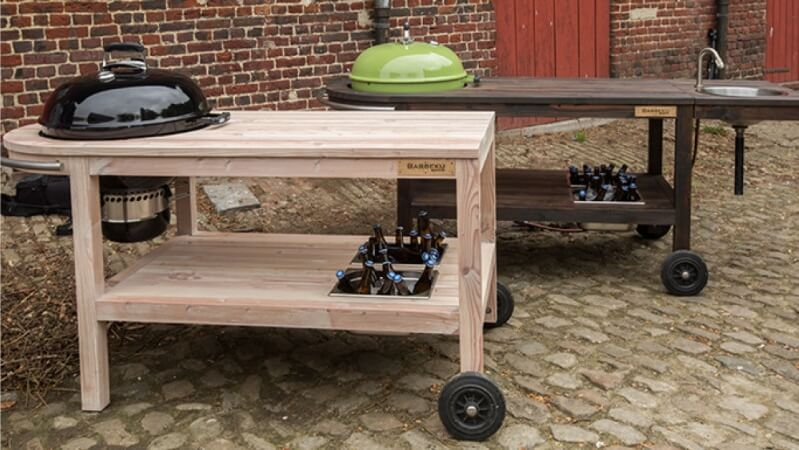 A couple wooden barbecue carts.