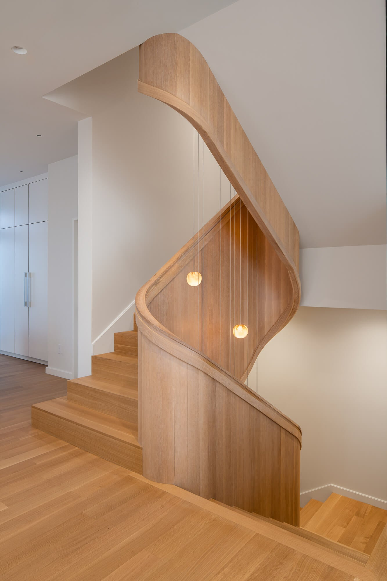 Rift sawn white oak staircase finished with a natural oil wood finish.
