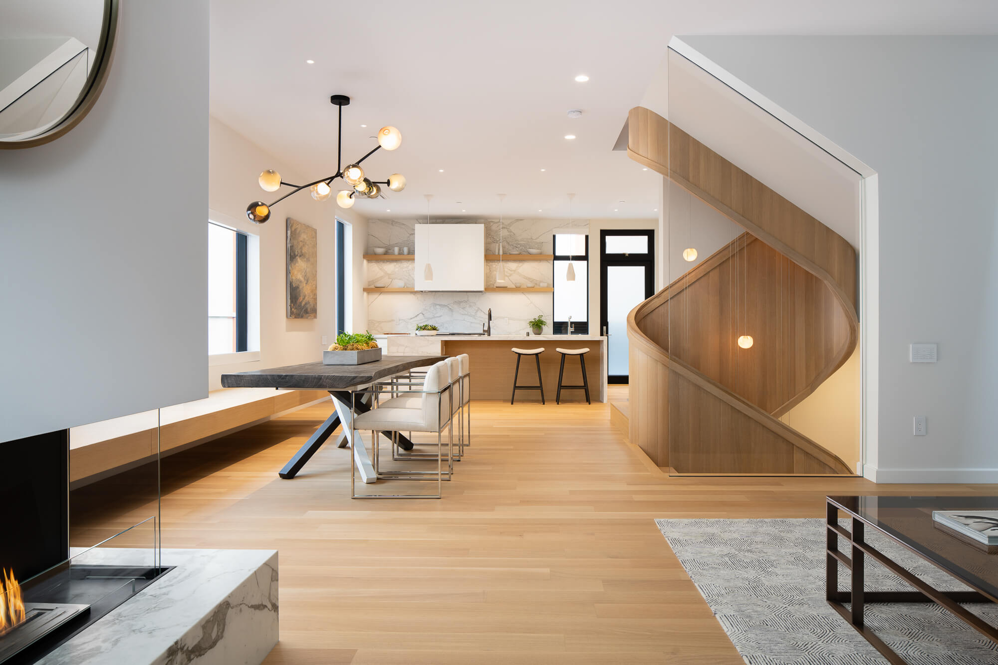 Rift sawn white oak flooring in living room and on spiraling staircase in townhome.