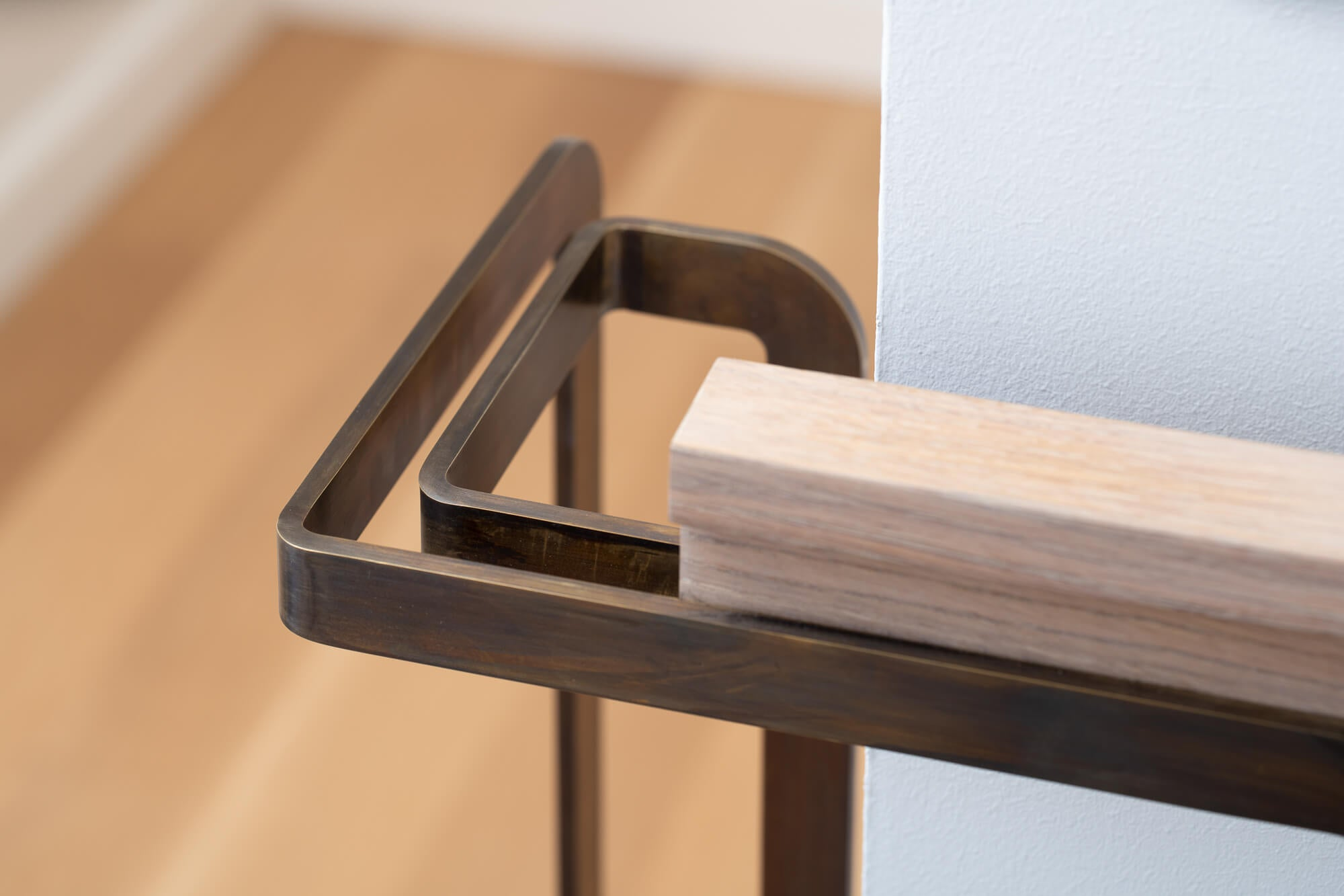 Detailed image of rift sawn white oak handrail for a staircase.