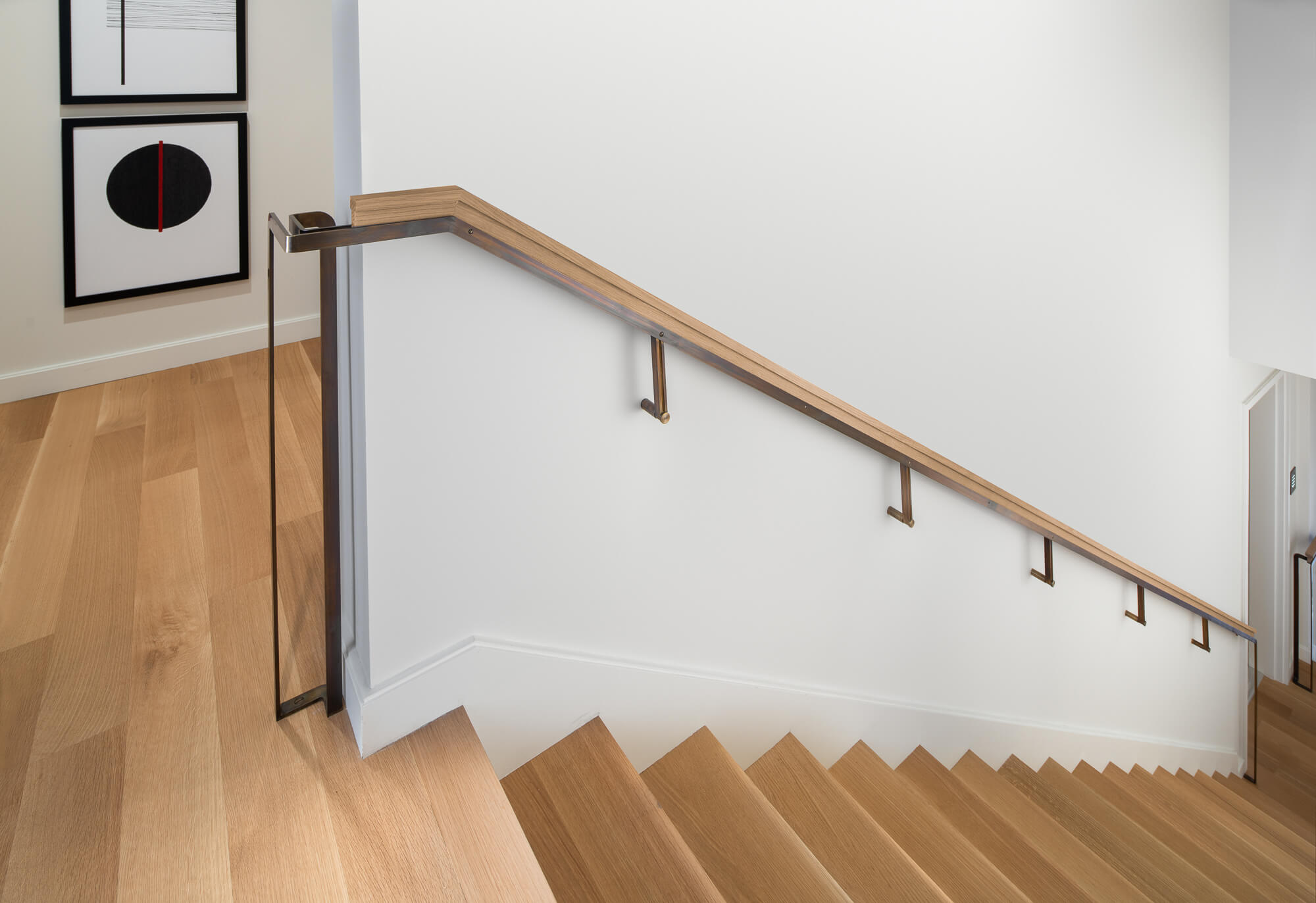 Rift sawn white oak stairs with wooden hand rail.