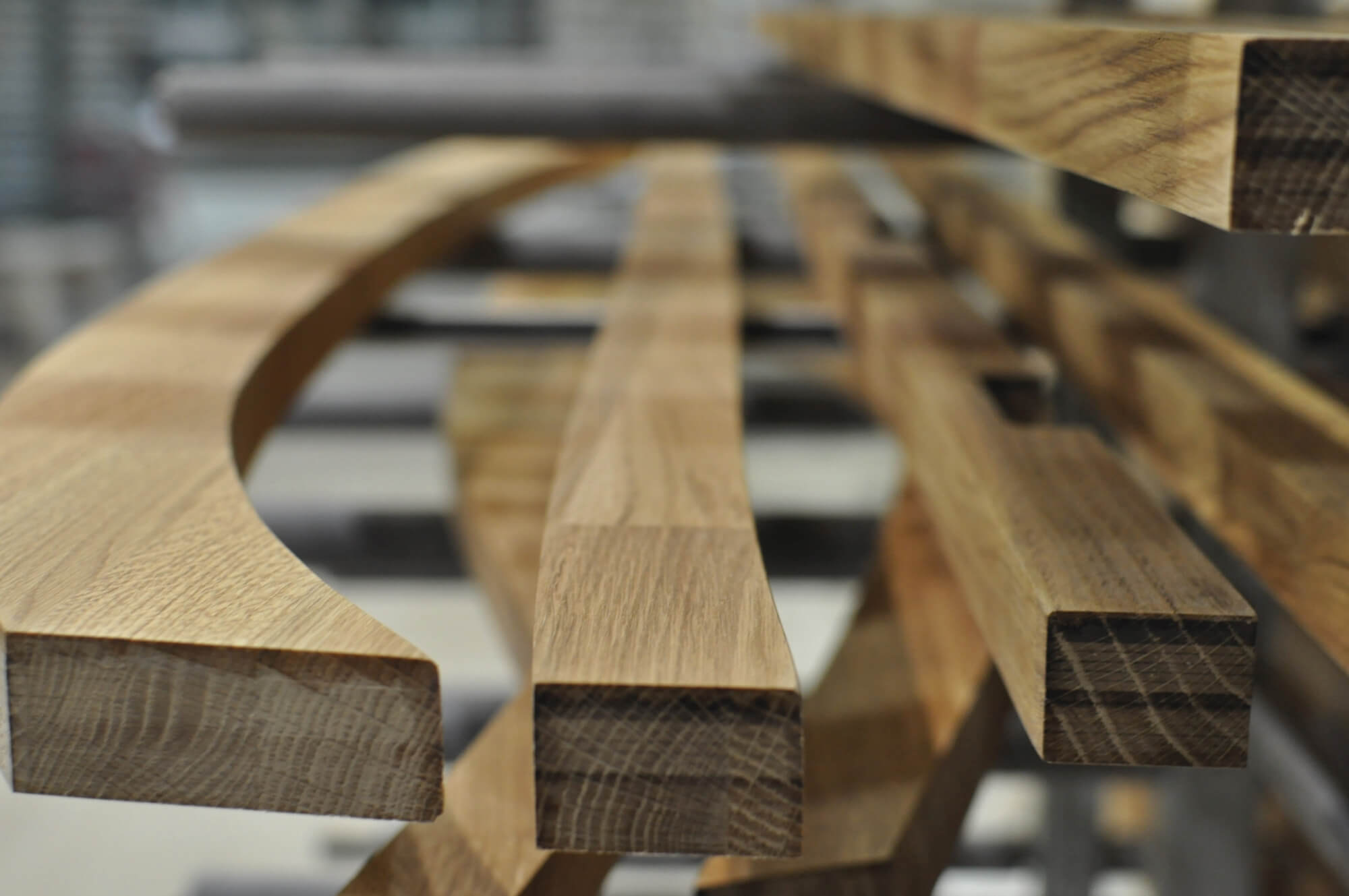Detail images of curved wood pieces.
