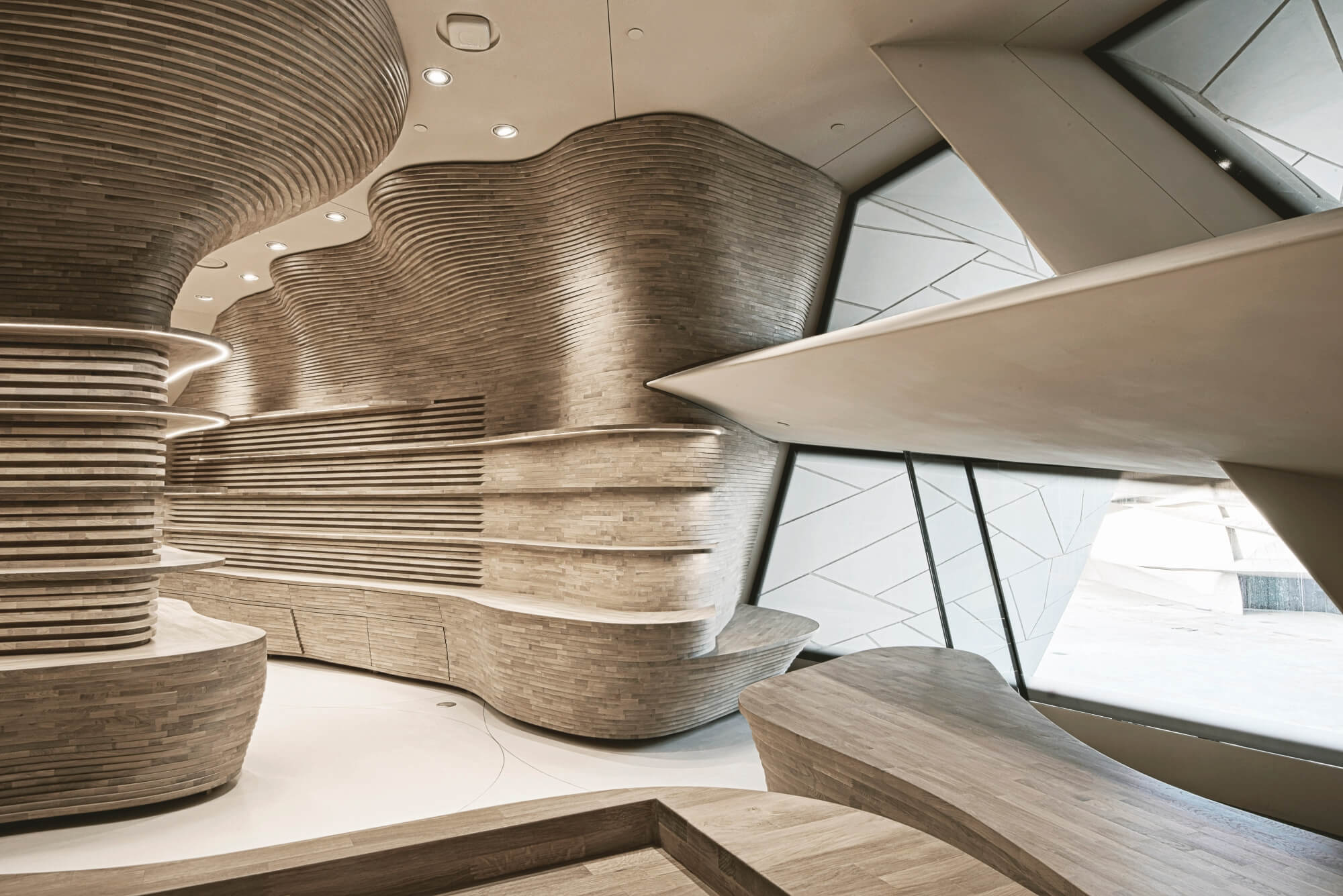 Gift shop designed using individual pieces of wood that contour to the curved flow of the room.