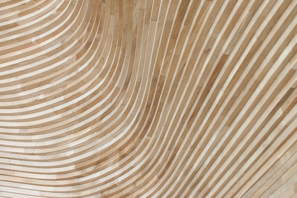 Curved wood pieces following curving lines.