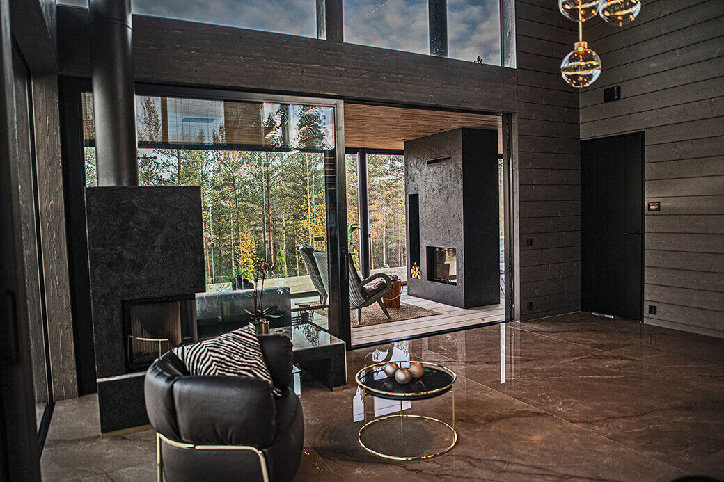 Luxury home interior with big glass windows viewing the forest