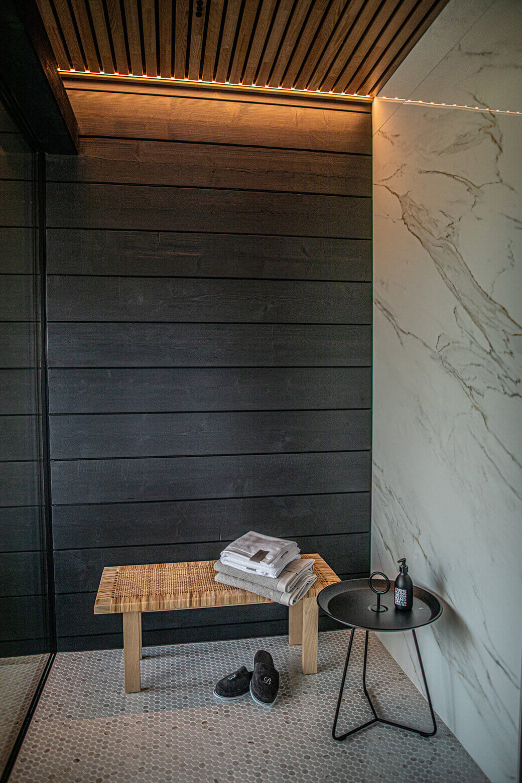 Ready nook with wood paneling and marble accent wall