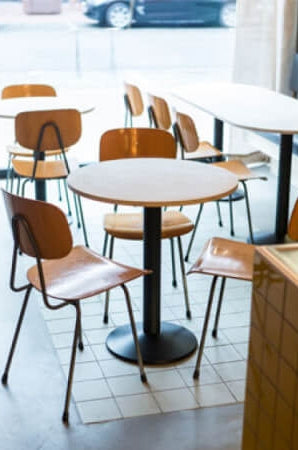 A table in a restaurant with a plant-based wood finish by Rubio Monocoat applied to it.