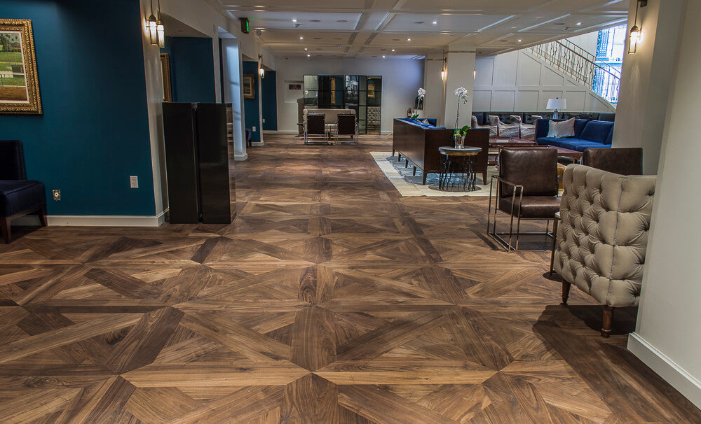 Elegant walnut wood flooring in a horse race track lounge.