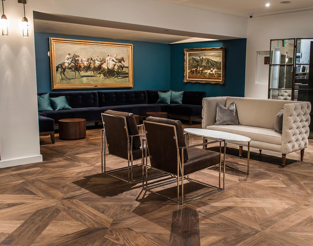 Walnut parquet flooring in a lounge.