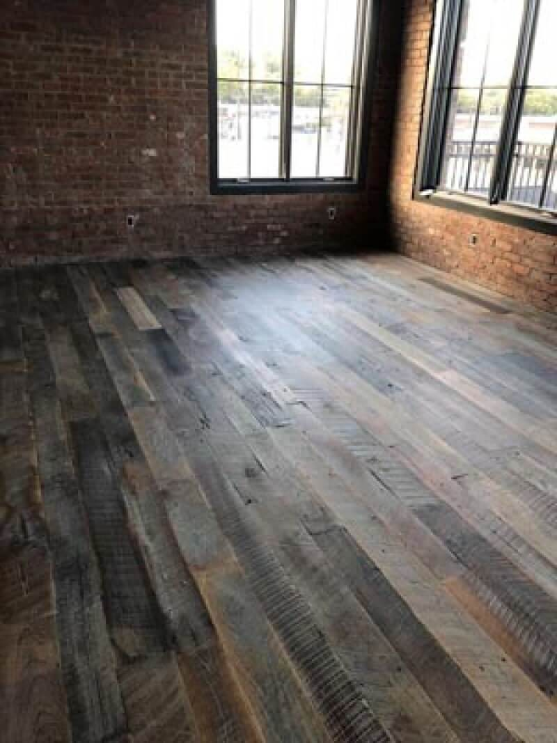 Hardwood with a rustic floor finish.
