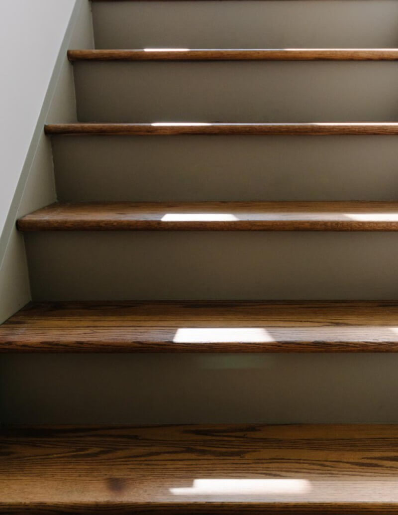 Sun on wooden stair case finished with Rubio Monocoat.