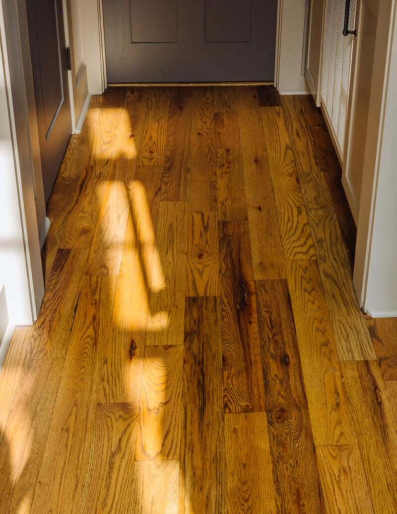 Sun dances across red oak floors finished with Rubio Monocoat.