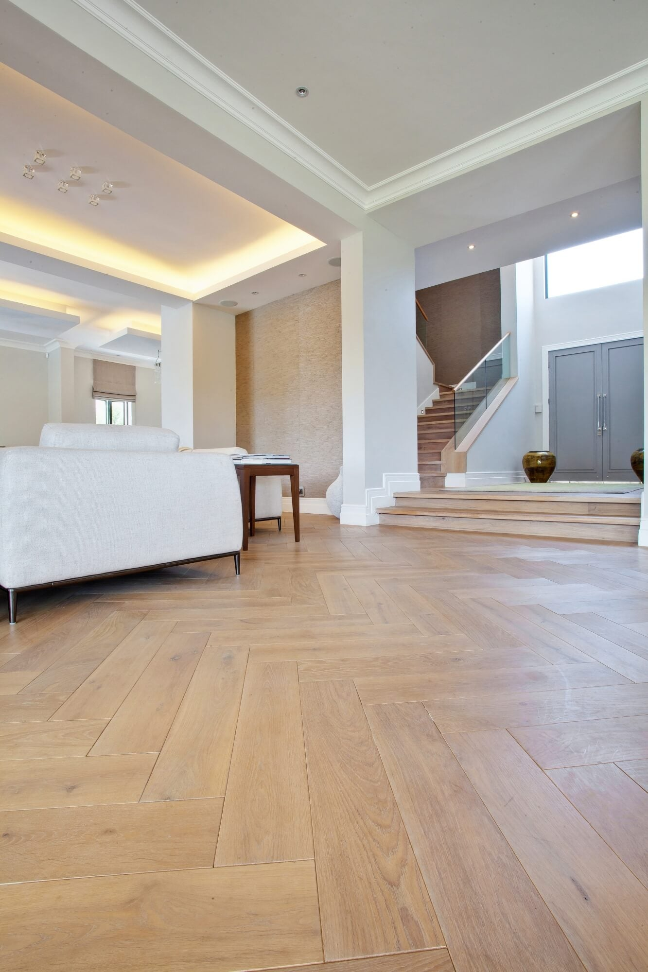 White oak herringbone floor finished with matte hardwax oil wood finish.