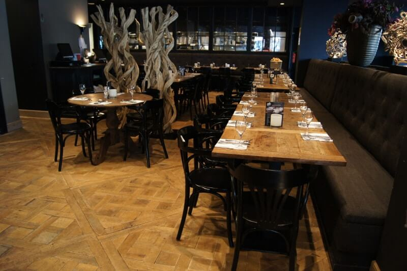 Restaurant in Belgium features wood flooring and furniture finished with Rubio Monocoat.