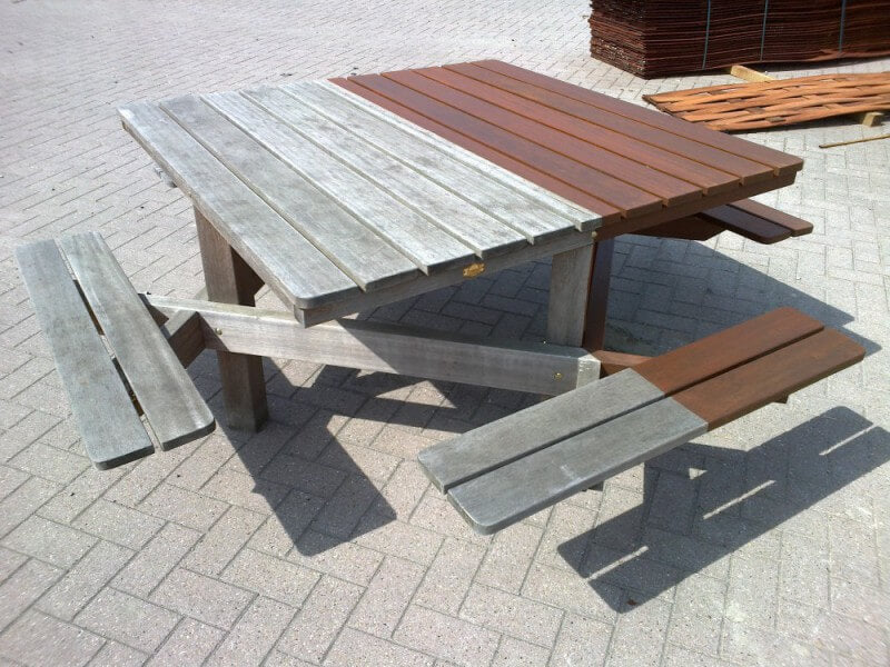 Outdoor wooden picnic table finished with Rubio Monocoat.