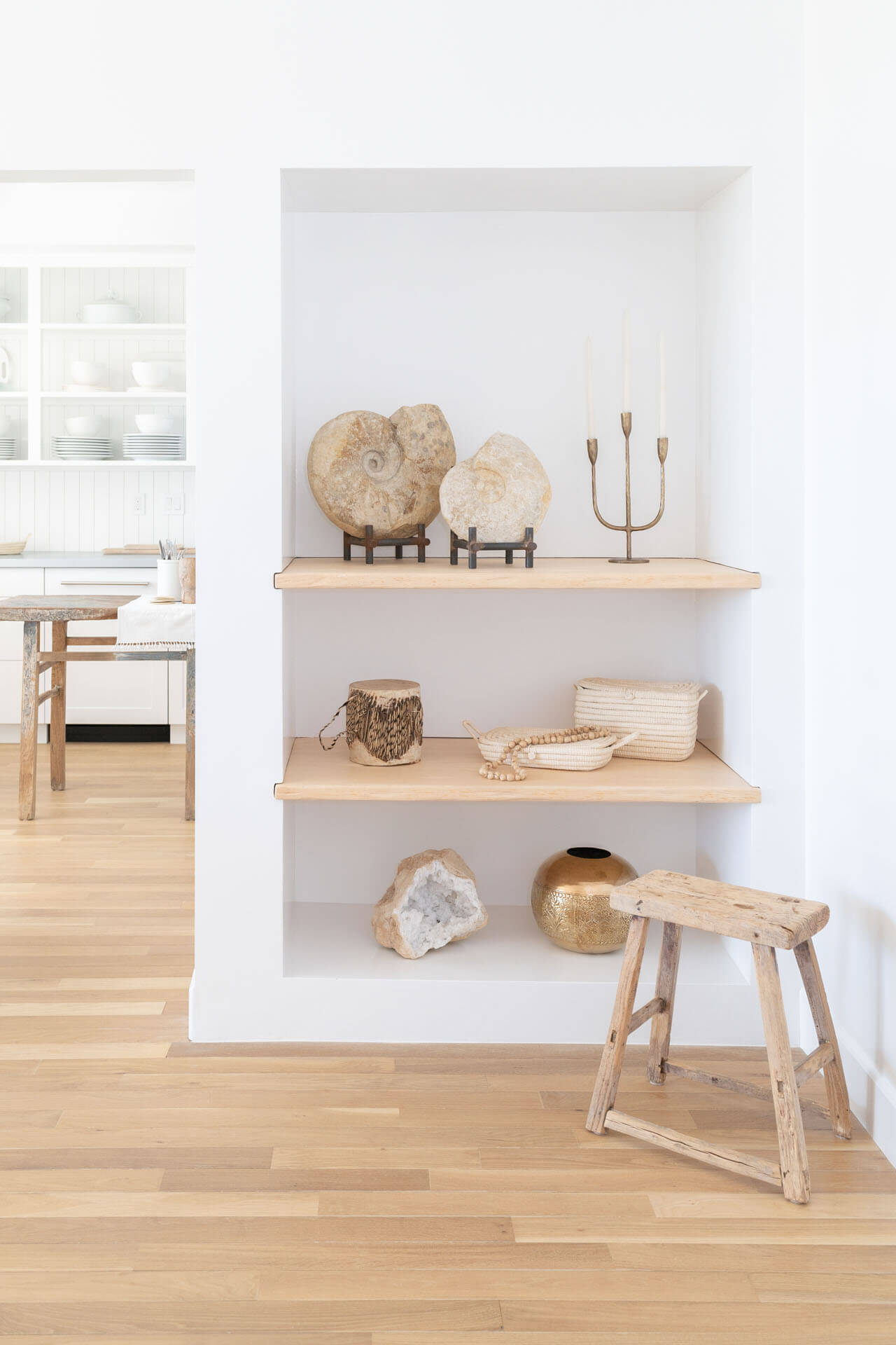 Built in living room shelving with natural hardwood flooring