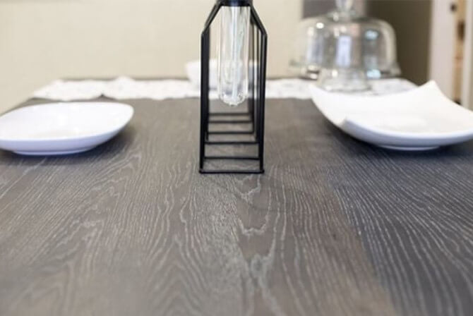 Rustic farmhouse design table with dark wood.