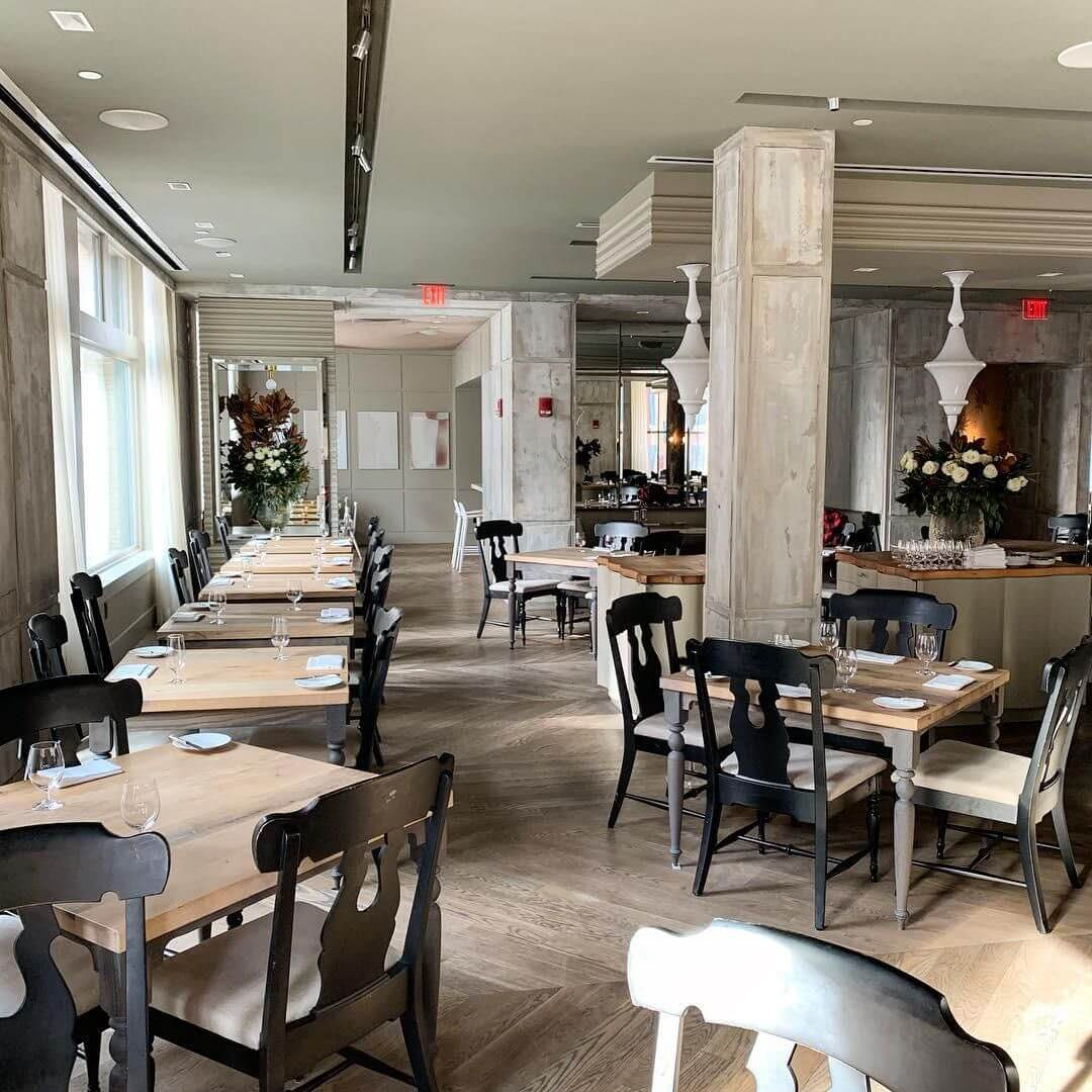 Restaurant boasts wooden tables and chairs made by Lighthouse Boston Woodworks and finished with Rubio Monocoat products.