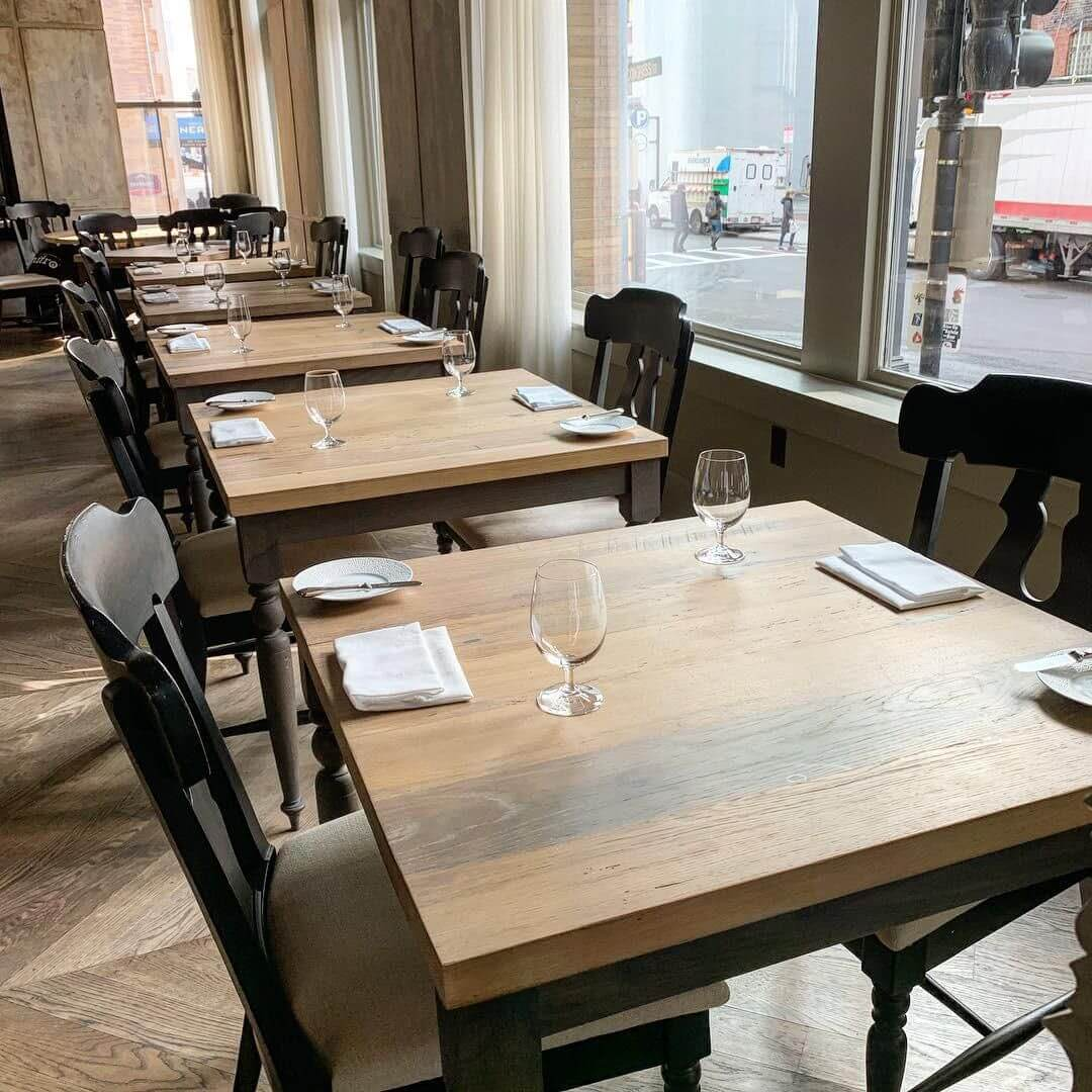 Rubio Monocoat used to color and protect white oak wood tables in Boston restaurant.
