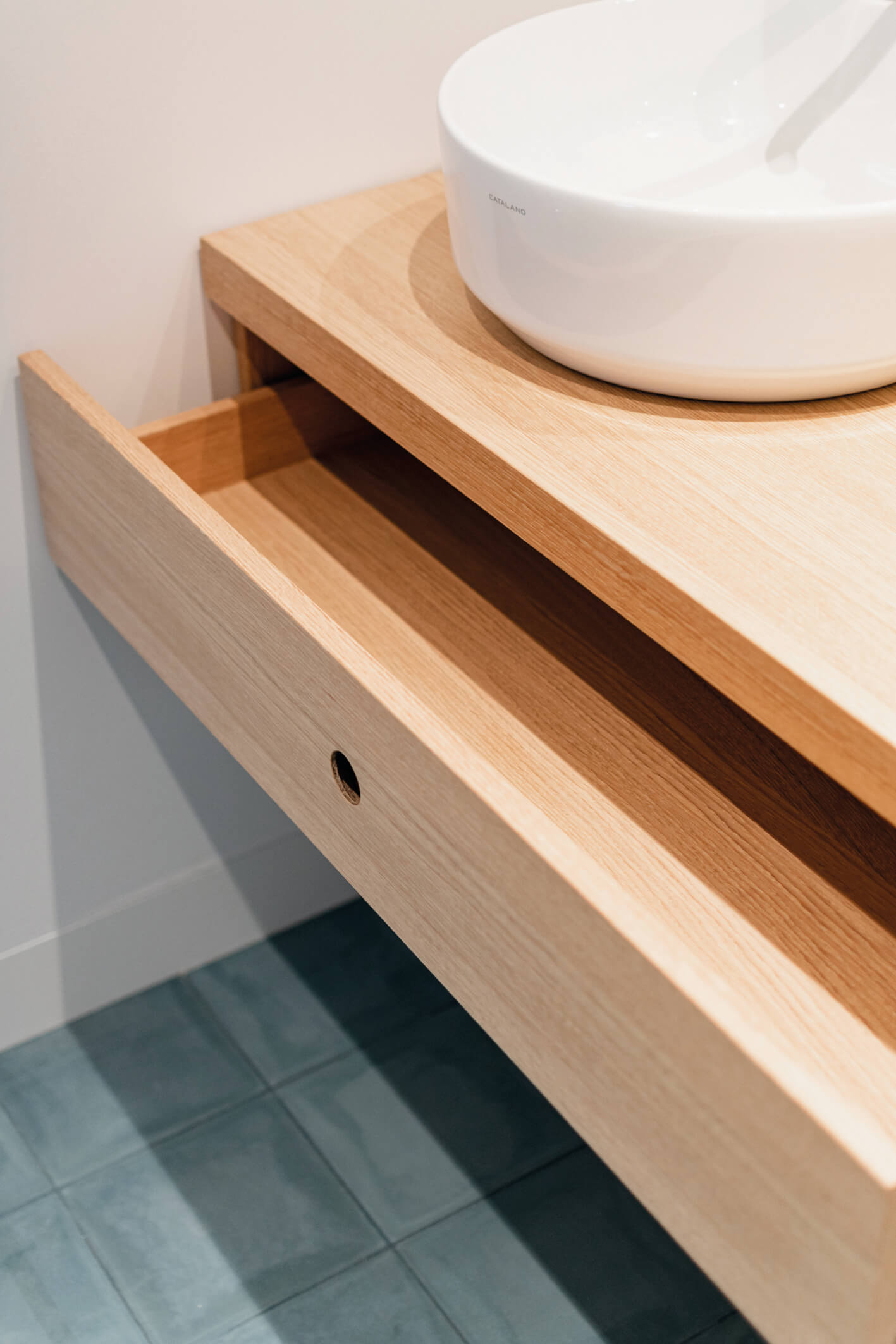 Bathroom sink features sleek drawer. All wood finished with Rubio Monocoat.