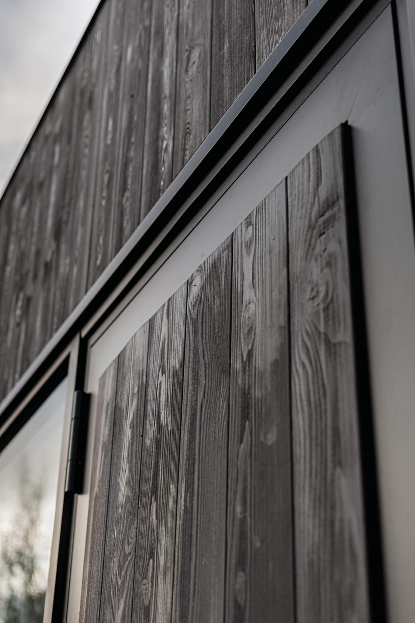 Rubio Monocoat's Hybrid Wood Protector used to protect exterior beech wood cladding.