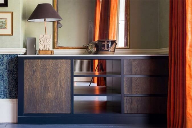 Modern vanity with cabinet and drawers made form metal and wood.