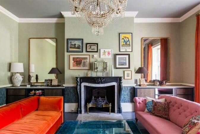 Eclectic living room with bold colored furniture.