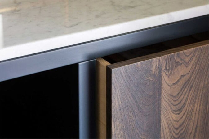 Detail shot of hardwood panel on front of vanity.