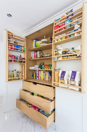 Beautiful pantry cupboard redesign with oak shelving and lots of drawer and shelf space.