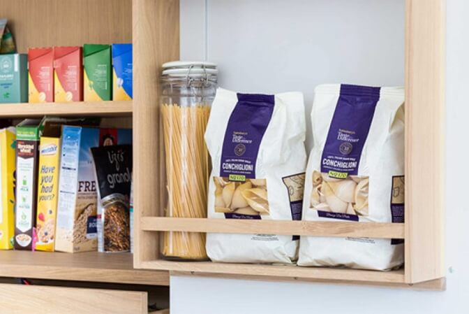 Natural wood shelves in a pantry cupboard.