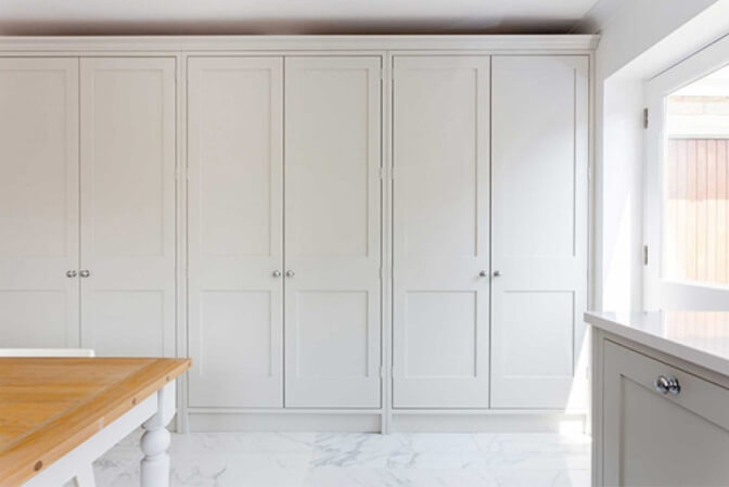 White shaker ceiling height cabinets.