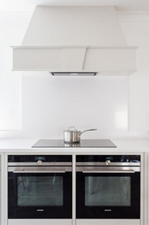 Modern and clean white shaker kitchen with two ovens.