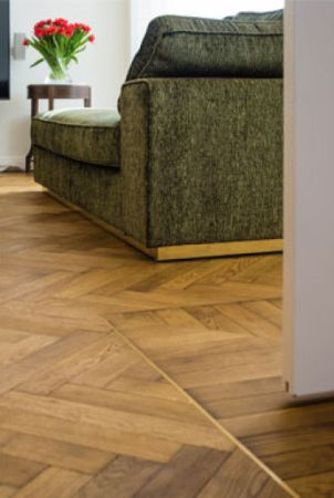 Details of wooden herringbone floors finished with Rubio Moncoat.