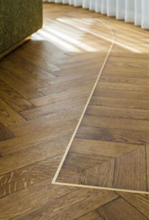 Details of inlay on herringbone floor finished with Rubio Moncoat.