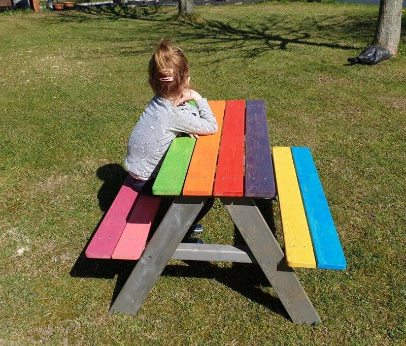 Childrens' picnic bench made with wood finished with colorful Rubio Monocoat products.